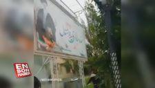 İran'da göstericiler Hamaney'in posterini yaktı