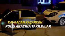 Kavgadan kaçarken polis aracına takıldılar