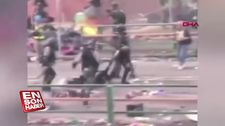 Polis yerde sürüklenen eylemcinin kafasına bastı