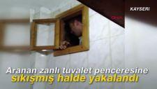 Aranan zanlı tuvalet penceresine sıkışmış halde yakalandı