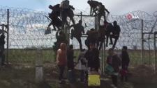 Mülteciler, Yunanistan sınırındaki engelleri aşıyor
