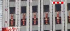 Çinli itfaiyecilerden 10 katlı binaya tırmanma gösterisi