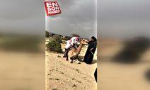 Üzerine binen ağır adamı taşıyamayan deve
