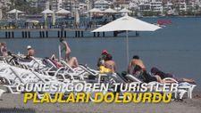 Güneşi gören yerli ve yabancı turistler, plajları doldurdu