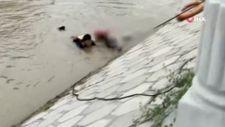 Çin'de kanala düşen kadını itfaiye erleri son anda kurtardı