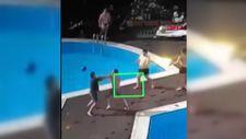 Beşiktaş'ta köpeği tekmeleyen site yöneticisi havuza atıldı