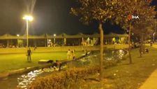 Arnavutköy'de sıcaktan bunalan çocuklar süs havuzuna girdi