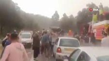 Cezayir'de orman yangını sırasında yağmur sevinci
