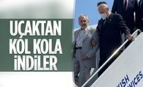 Kıbrıs'a giden Devlet Bahçeli, uçaktan Oğuzhan Asiltürk ile kol kola indi