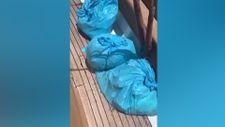 Muğla'da çöp dolu poşetleri denize attılar