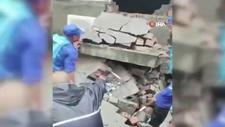 Çin'i vuran selde çöken evin altında kalan bebek
