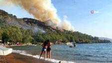 Marmaris'te tatil ve yangın bir arada