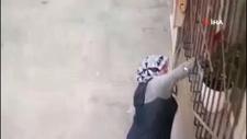 Bursa'da camdaki çiçeği çalan kadın kamerada