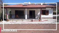 Muğla'da yanan evleri yapılan aileye Murat Kurum'dan 'Hayırlı Olsun' açıklaması