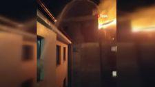Amasya'da bir vatandaş, karşı apartmandaki yangına hortumla müdahale etti