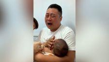 Çin'de çocuğu koronavirüs aşısı olan babanın zor anları