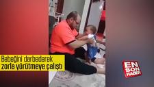 Bebeğini darbederek zorla yürütmeye çalıştı