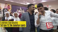 Evlenen kardeşine 50 bin TL'lik telefon taktı