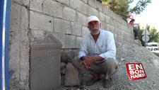 Tarihi mezar taşından duvar yaptı