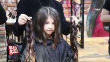 Beline kadar uzattığı saçlarını LÖSEV'e bağışladı