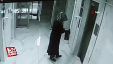 Binalara girip elindeki sıvıyı her yere süren kadın