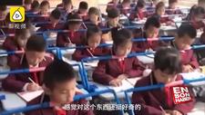 Çin'de öğrencilerin dik oturması için masalara düzenek kuruldu