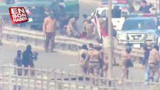 Irak polisinden göstericilere dayak