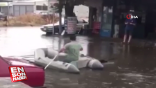 Çanakkale'de yağmur sonrası botuyla dışarı çıkan adam