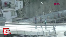 Köprüden atlarken vatandaşlar kolundan yakaladı