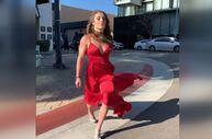 Yolun karşısına ters takla atarak geçen kırmızılı kadın